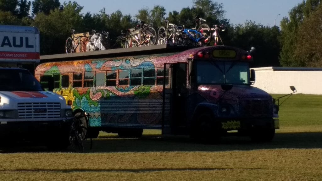 A colorfully decorated school bus transports riders and bikes during BRAG's fall ride.