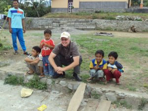 Bill Harris of Cafe Campesino hanging out with the kids of Permata Gayo coffee farmers in Sumatra
