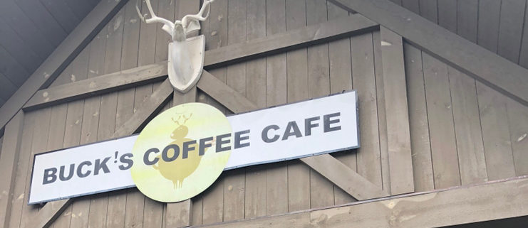 bucks coffee cafe sign with antlers on top
