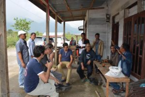 Florent Gout (center left) Cooperative Coffees green coffee buyer, listens to Permata Gayo members and leaders during a visit to northern Sumatra.