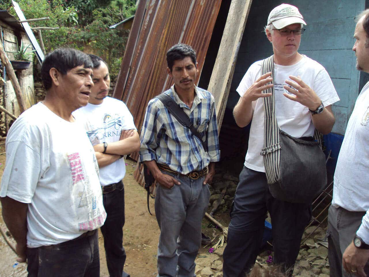 Bill with coffee farmers in Guatemala in 2011.