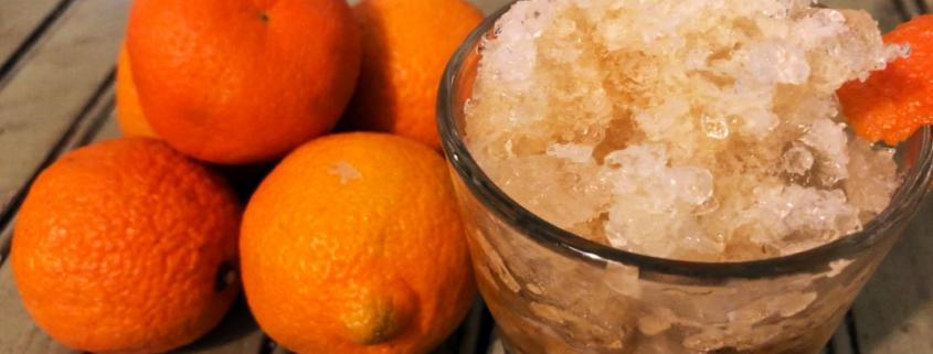 Homemade coffee granita garnished with orange zests