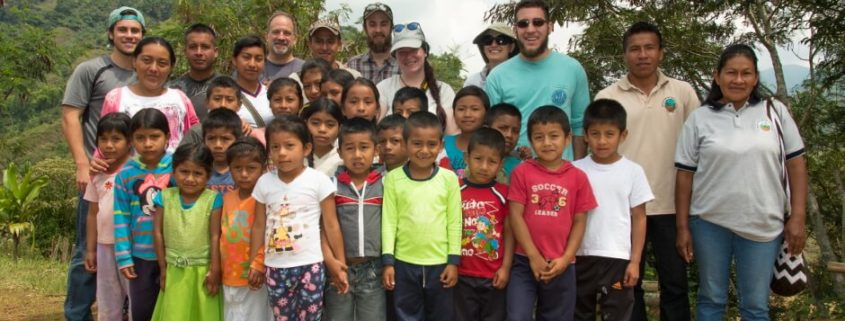 Hannah Mercer Cafe Campesino sales, customer service and training representative is pictured center with school children in La Nueva Colonia a community located deep in the coffee-producing highlands of the Cordillera Central mountains of Colombia