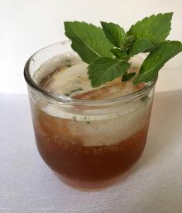 Coffee Cocktail with Basil Garnish